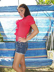 Brunette babe with long sexy legs Valentina has a new photo session