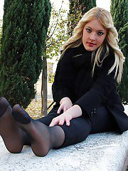 Smooth looking blonde babe Christelle in foot fetish mood outdoor
