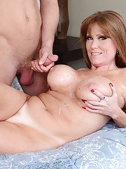 Dazzling brunette mom with huge boobs Darla adores sucking dicks