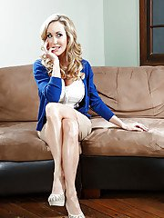 Brandi Love is taking off her sexy lingerie and posing naked