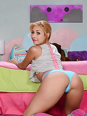 Carmen Caliente has her sexy socks on and is doing some posing