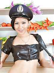 Latina babe Agnes is posing in a hot police uniform on a kitchen