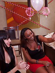 Ebony slut and her friend are having fun with a stripper on their party