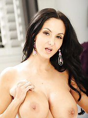 Brunette milf Ava Addams is teasing her big tits in a sexy dress