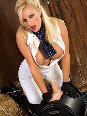 Sybian slut with big tits Michelle Thorne doing some posing in boots