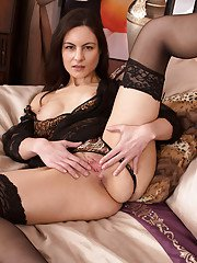Milf brunette in sexy stockings Michelle Khan does some posing