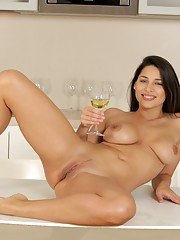 Brunette babe Zafira is taking part in a pissing scene on a kitchen
