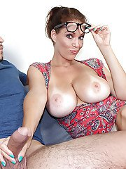 Clothed milf babe with big tits and sexy glasses doing handjob