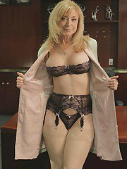 Blonde mature babe Nina Hartley is showing her big tits in stockings