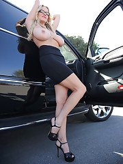 Milf chick Kelly Madison is demonstrating her big tits in a car