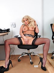 Stockings model Dannii Harwood is showing her ass while doing striptease