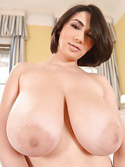 Close up undressing action from an amazing brunette Luna Amor