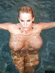 Outdoor posing scene at the pool features amateur milf Kelly Madison