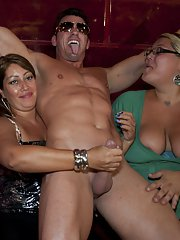 Ebony babes and sexy white chicks enjoy an CFNM party with strippers