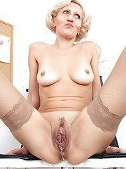 Blonde mature Sava demonstrates her shaved pussy to her doctor