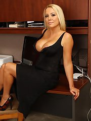 Office babe Tara Star dose some undressing at her working table