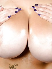 Big tits fatty Terri Janes demonstrates her sexy tattoos in close up