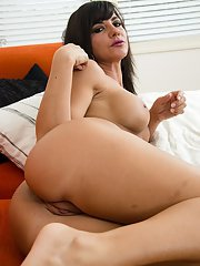Very beautiful MILF babe masturbating on the couch naked