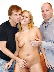 Threesome sex with a busty milf in hot stockings and two guys