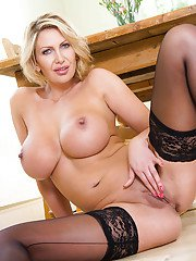 Milf babe with big tits Leigh Darby shows off in her black lingerie
