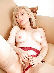 Mature slut with big tits Nina Hartley shows off in lingerie