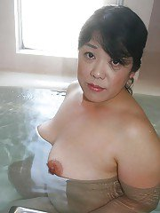 Mature brunette Eiko Imamiya enjoys hot bath and shows her Asian tits