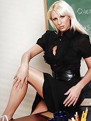 This blonde teacher Emilianna is ready to spread her long legs