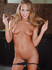 Blonde with tight and hairy pussy Carter is showing her goods