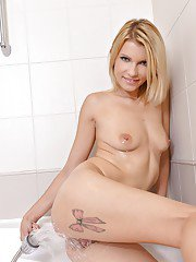 Close up shower features a perfect milf babe with tattoos Karina Grand
