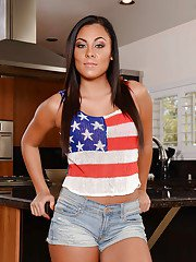Latina mom Gianna Nicole teases her tight pussy on a kitchen table