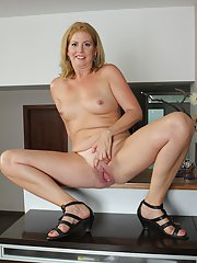Tiny tits mature babe Laura Oswald demonstrates her pussy and ass