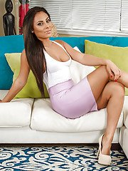 Tanned brunette Gianna Nicole is posing naked on the cute couch