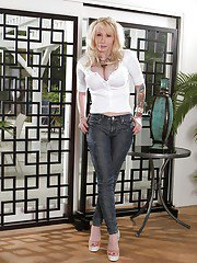 Blonde with long legs Candy Manson is posing without her lingerie
