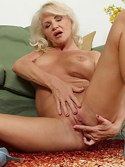 Curly-haired blonde Iris is penetrating her accurate shaved puss