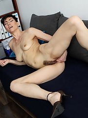 Hot mature Halle B. is penetrating her nice pussy after undressing