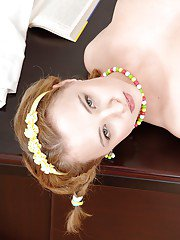 Pigtailed big-titted babe with nice face Lolly Moon is getting naked