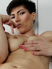 Skinny mature brunette Halle B. is drilling her hairy tight hole