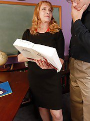 Fatty mature office chick Erica is giving a nice deep blowjob