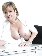 Mature Lady Sonia love to pose and play with her natural big tits