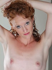 Mature chick Ande shows her skinny body and slender long legs