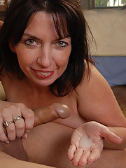 Hardcore dark-haired lady Scarlette is giving a nice handjob!