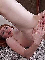 Redhead mommy Molly Gingham poses with naked boobies in close-up