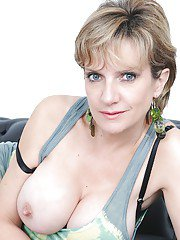 Mature Lady Sonia pokes her puss and poses in hot black stockings