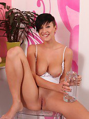Big-tit brunette Nicoleta is penetrating her tight vagina on the cam