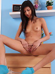 Asian brunette Yukiko is pissing on the floor and playing with puss