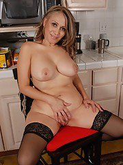 Busty beauty SashaSky takes off her dress right in the kitchen