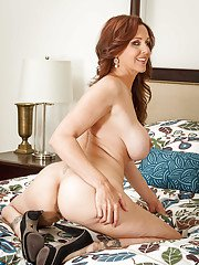 Mature Julia Ann poses in her lingerie and plays with hairy pussy