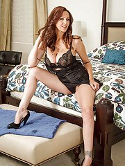 Milf Julia Ann takes off her luxury lingerie right in the bedroom