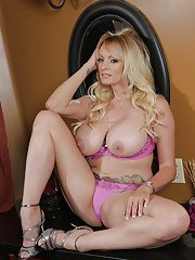 Babe milf Stormy Daniels takes off her clothes and plays with snatch