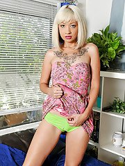 Milf blonde Coco Velvet is showing off her tattoos and camel toe